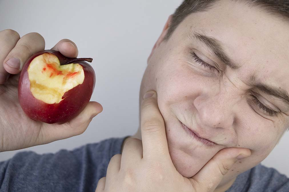 These Foods Treat Gum Disease (And Those Cause It)